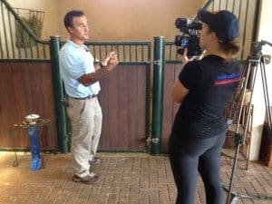 Maat holding the camera for WPTV reporter during an interview