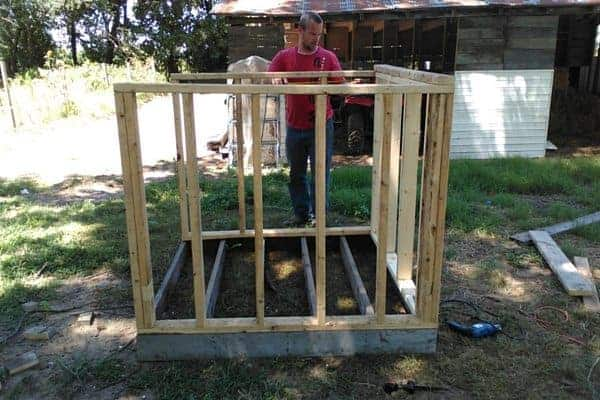 Make your own DIY chicken tractor using these plans and pallet wood. Easy step-by-step plans. From FrugalChicken