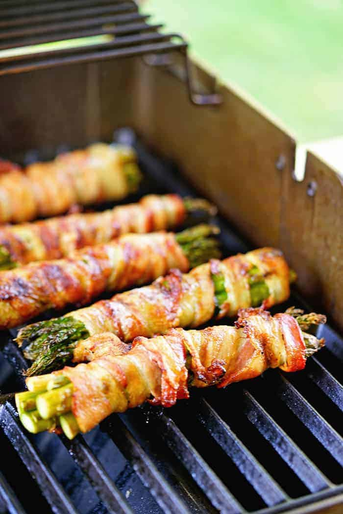 Grilled Bacon wrapped Asparagus being cooked on the grill