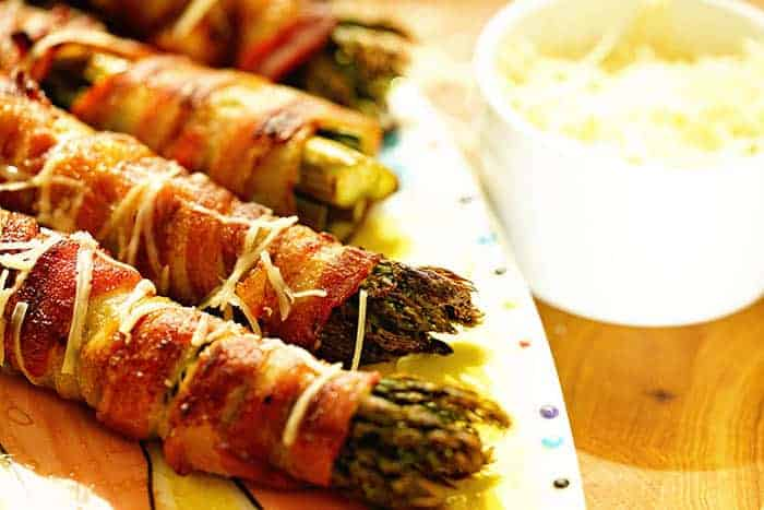 Grilled Bacon Wrapped Asparagus on a platter, ready to serve!