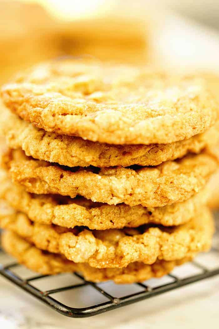 A stack of oatmeal peanut butter cookies on a cooling rack.
