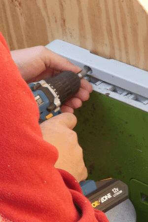 Screwing Door To Duck Coop